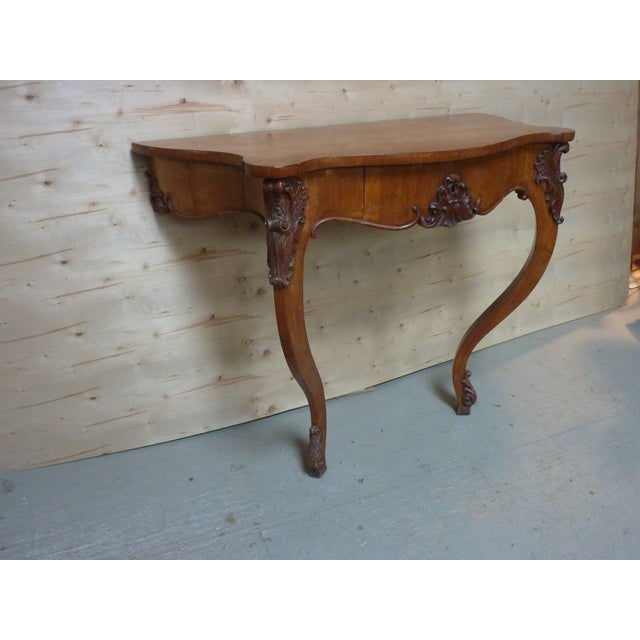 19th century carved rococo style continental fruitwood wall console with single, dove-tailed drawer, anchors to the wall.