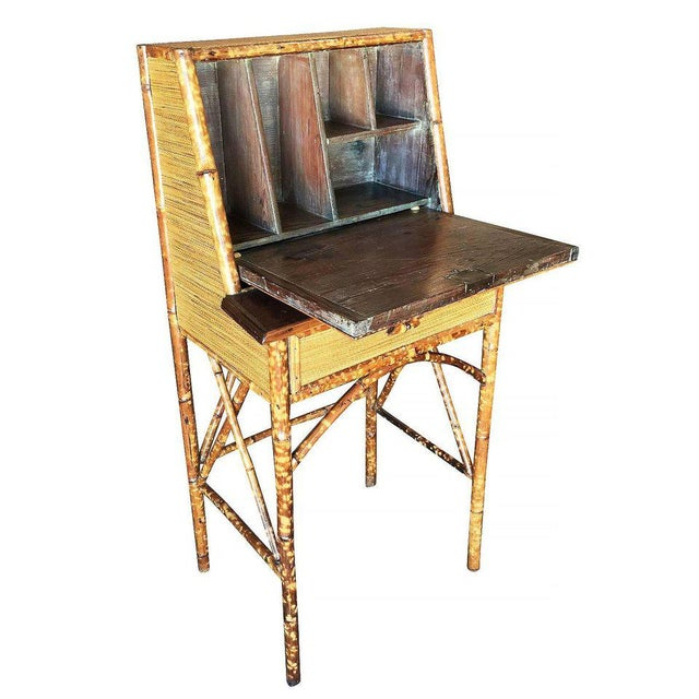 Tiger bamboo secretary desk with handwoven rice mat coverings, center drawer and flip down front opening to five small...