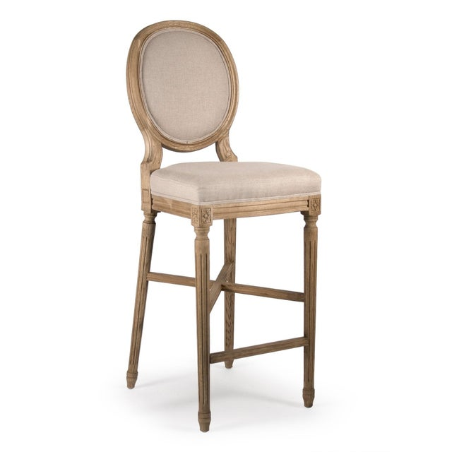 Round back bar stool with natural finish upholstered in natural linen.