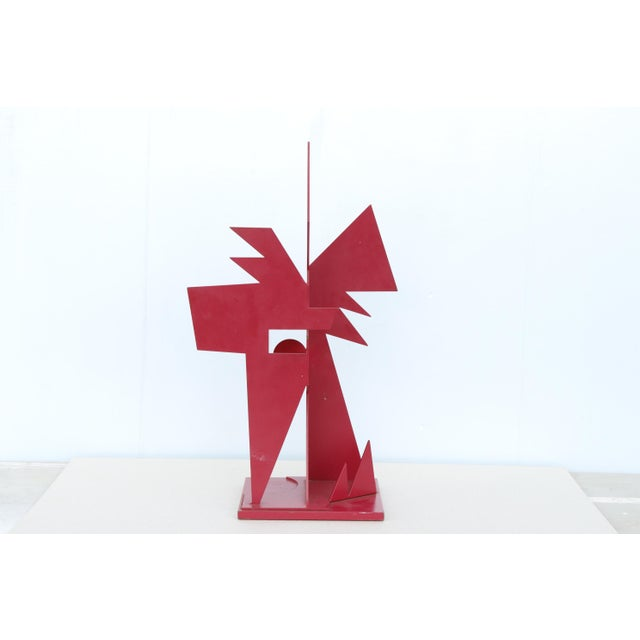 "A bright red painted steel sculpture titled ""Corten Steel"" by contemporary abstract artist Jay Lefkowitz, signed on the..."