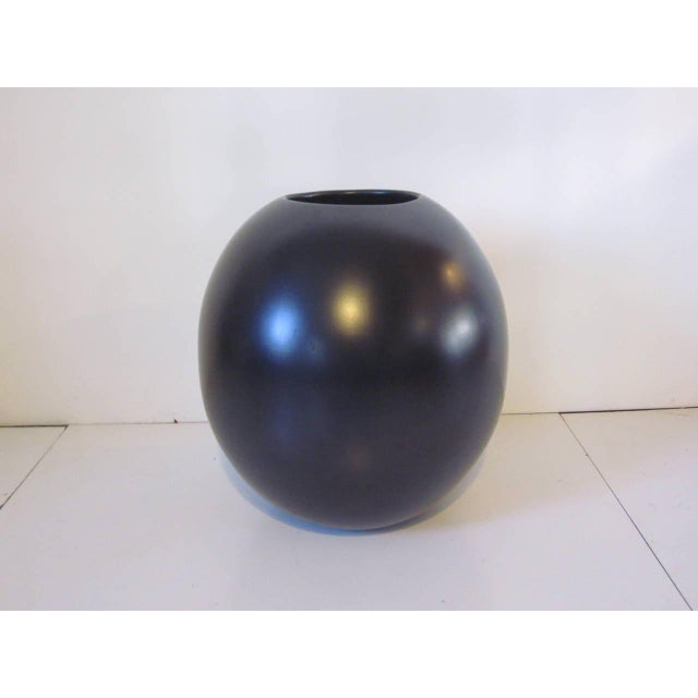 A satin black monumental Marilyn Kay Austin wide mouth high fired clay designer pot / planter. These pots came in a wide...