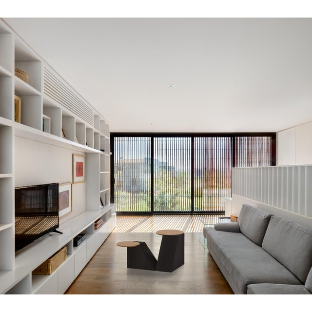 Incorporates the designer's architectural background by combining the simplicity of different forms into a unique...