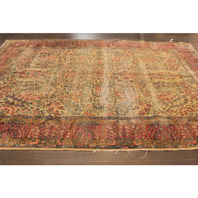 A hand-knotted Antique Persian Kerman Rug with a geometric design on a multi-color field.