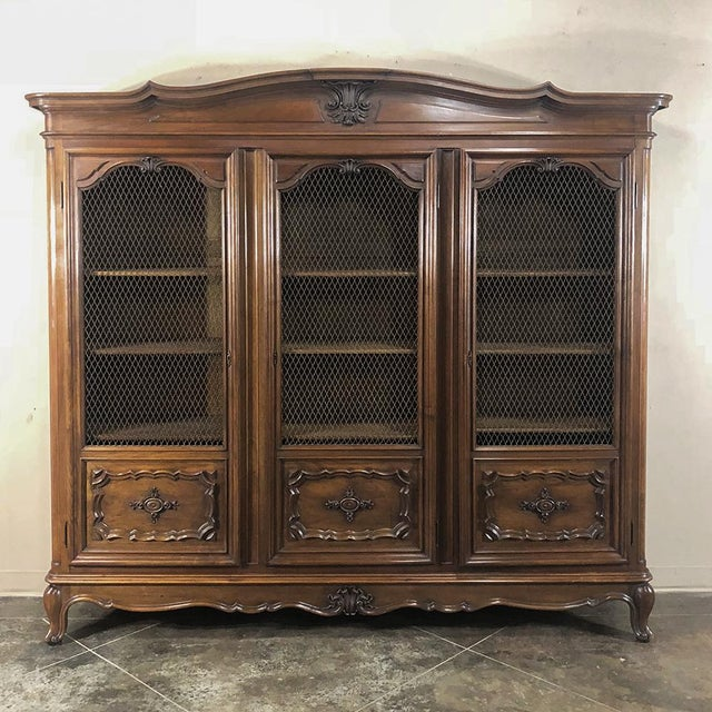 Antique Italian Walnut Piemontese Triple Bookcase features the graceful lines of the restrained Rococo styling typical of...