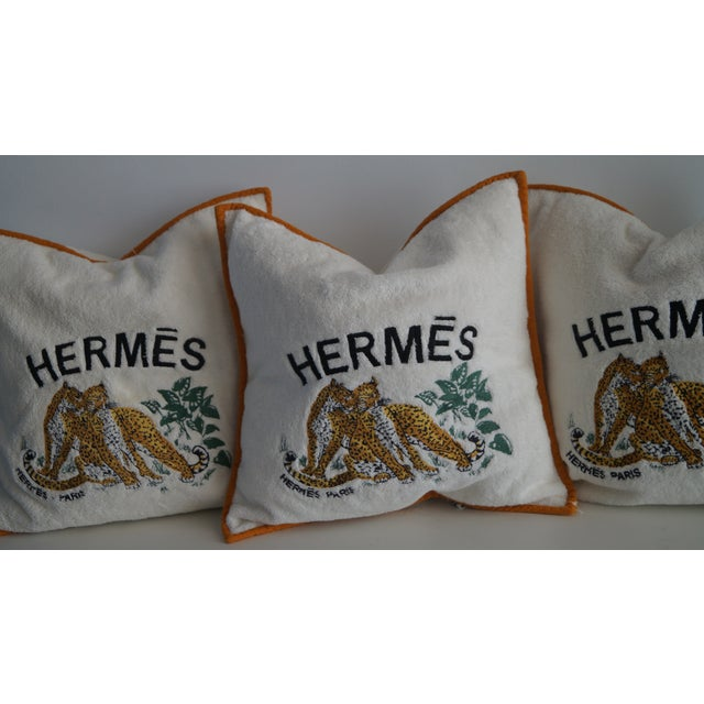 Rare Hermes Cushion Covers. Large logo and Tiger embroidery. Orange piping details. Zipper in the back of the pillow.