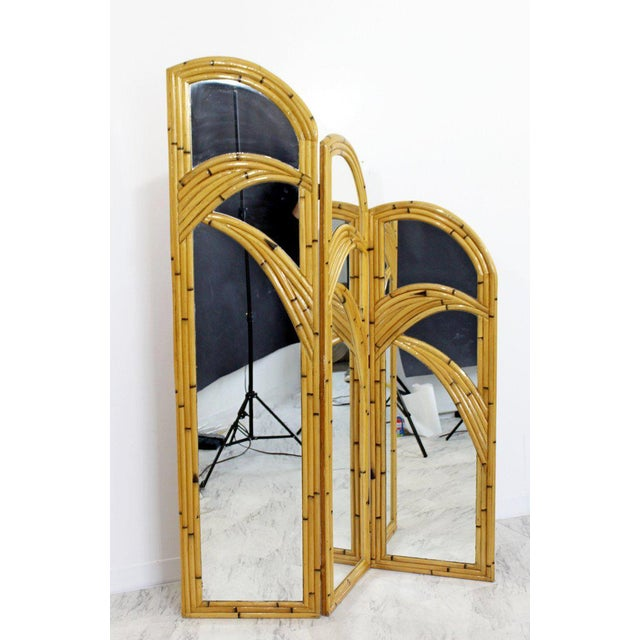 For your consideration is a phenomenal, intricate rattan and mirror, 3 sided screen room divider, circa the 1970s. In...