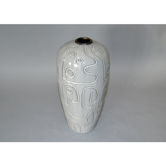 Charming modern glazed pottery vase in gray. It is a studio piece and has no markings.