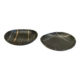Late 20th Century Japanese Black Pottery Catchall Bowls With Varied Gold and Silver Striations For Sale
