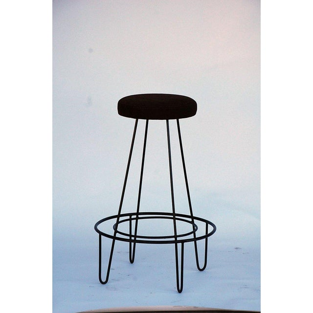 Pair of minimalistic bar stools with brown suede seats.