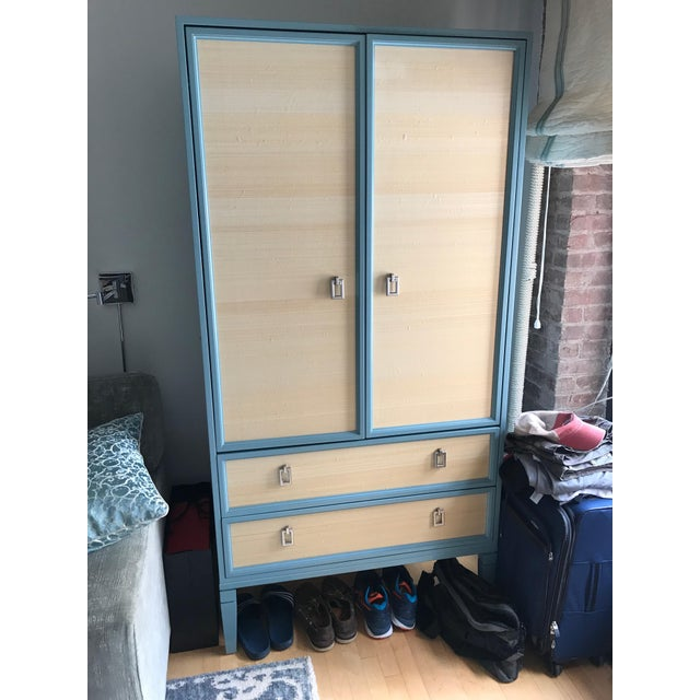 This New Traditionalists custom made armoire with Philip Jeffries wallpaper is a great piece for any room. Sturdy doors...