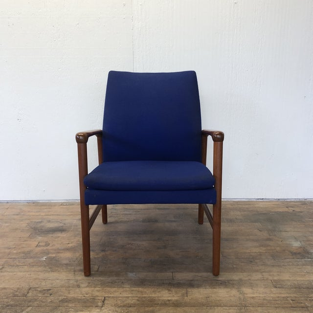 Stunning teakwood armchair with blue fabric by Fritz Hansen. This chair has a beautiful frame in wonderful condition and...