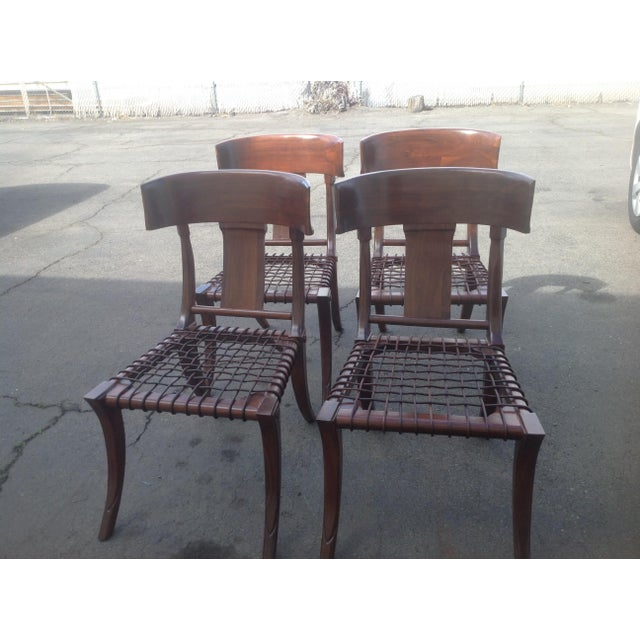 Set of 4 solid walnut Robsjohn Gibbings style Klismos Dining chairs. Chairs are done in Matte finish. The set of 4 chairs...