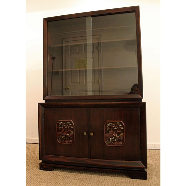Offered is a nice Mid-Century Asian Modern china cabinet. It was designed by James Mont for Thomasville. Features two...