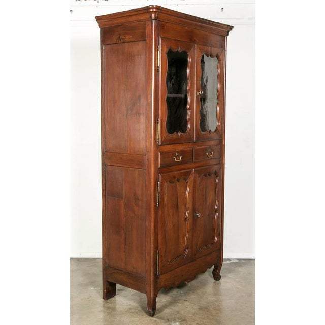 Beautiful 18th century period Louis XV solid cherry garde manger featuring a stepped cornice above two pair of doors with...