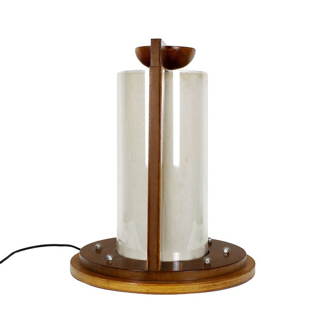 Table lamp, MDF with applications of beech and pine wood, central plexiglass cylinder with parchment paper inside. Three...