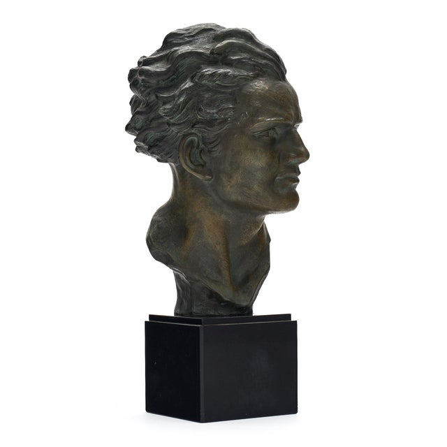 French Art Deco spelter bust of Jean-Mermoz. This piece has a beautiful green patina and black marble base. Jean-Mermoz...