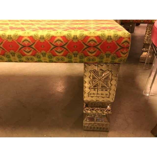 This beautiful, custom upholstered long bench, with hand-chased German silver legs. The hand-carved, square post legs are...