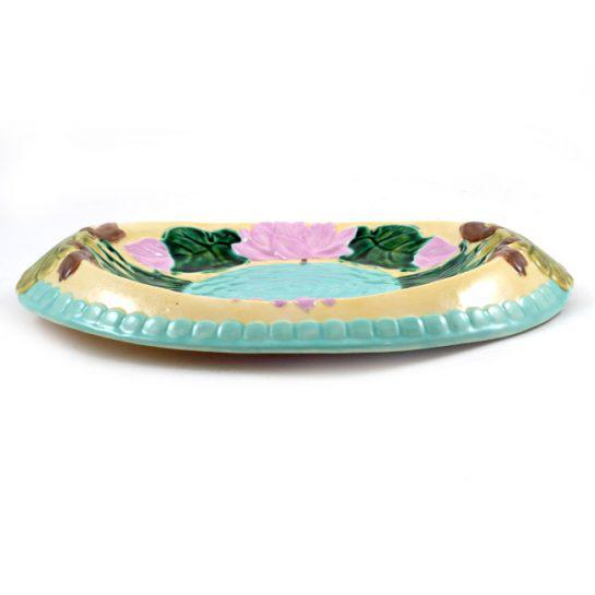 Majolica Oval Platter hand painted has palmette designs on each side of its painted rim. The plate's interior has large...