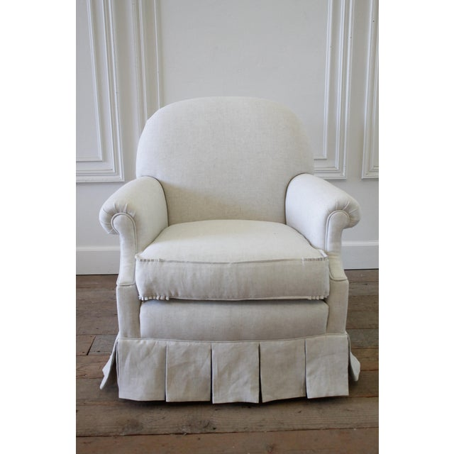 Vintage chair with custom upholstered linen box pleated ruffle skirt. If you sat in this chair you would want to purchase...
