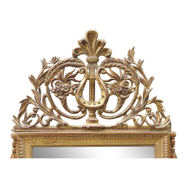 This intricate mirror was made in Italy during the late-18th Century, circa 1790. This piece features a gilt carved crest...