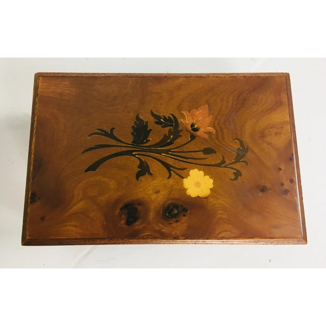 This is a handmade inlaid walnut dresser box with Inlaid satinwood floral pattern to the top. Made in Italy circa 1990