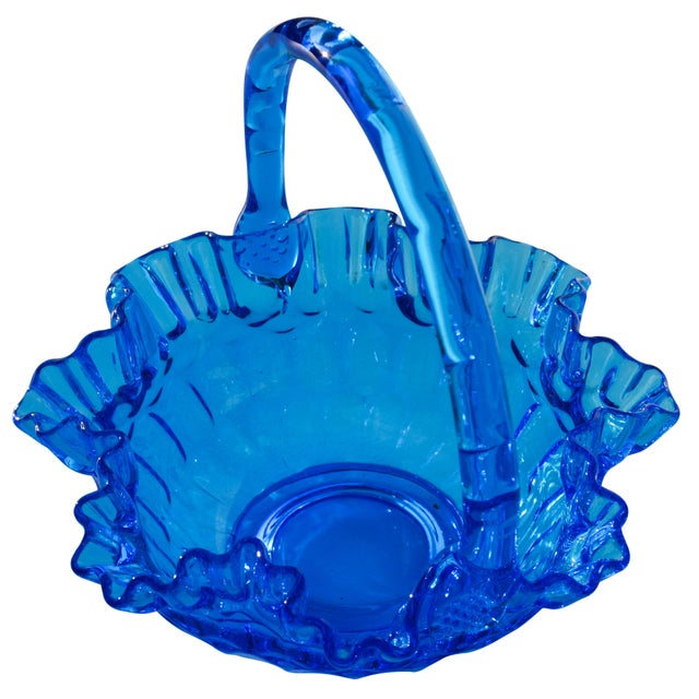 Midcentury handblown blue glass basket with ornate structure and intricate details.