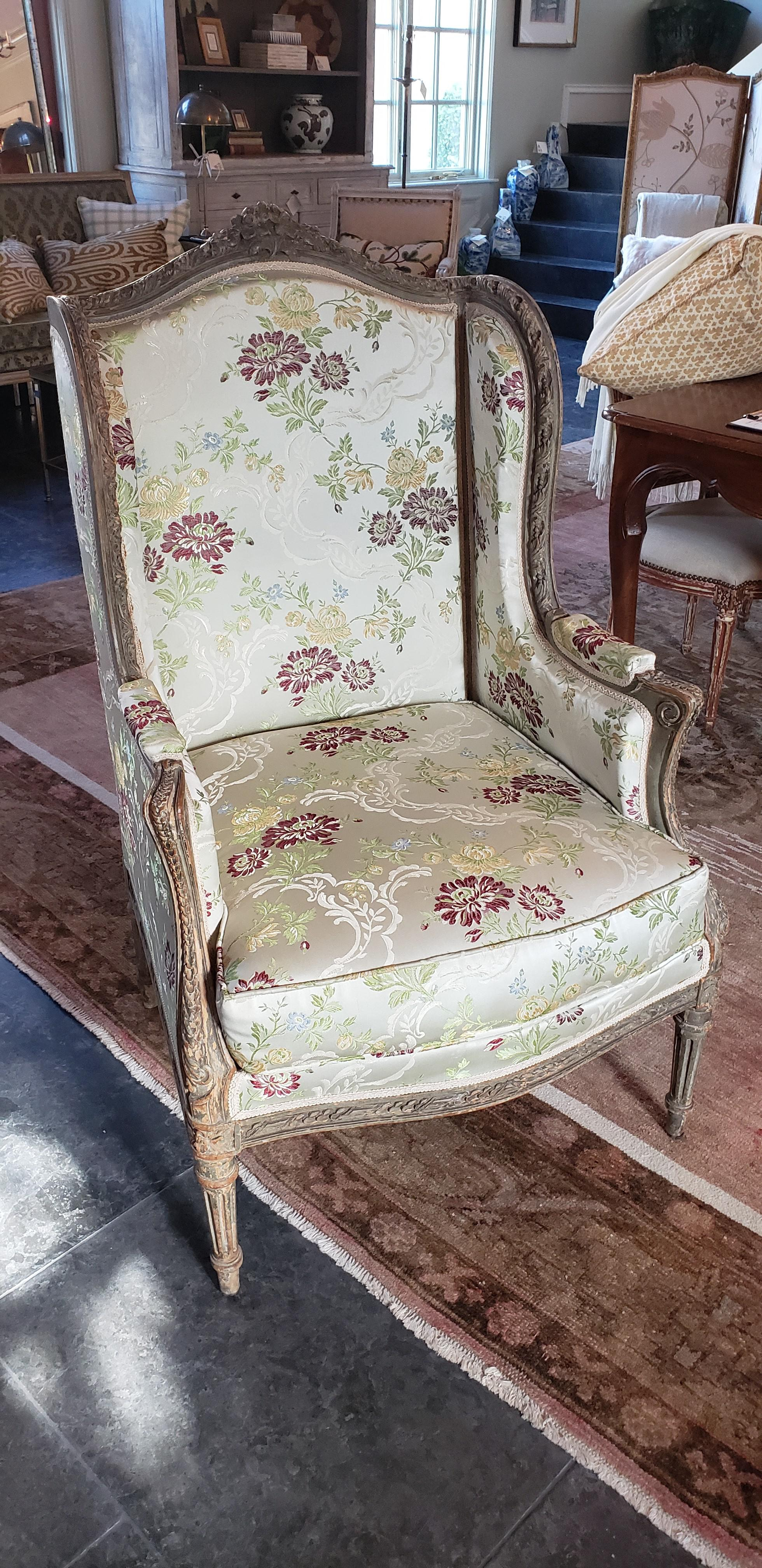 Beautifully Carved Upholstered French Wing Back Chair.