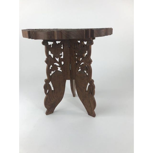 Beautiful carved wooden plant stand from India. This little piece can be used as a foot stool, low table or plant stand in...