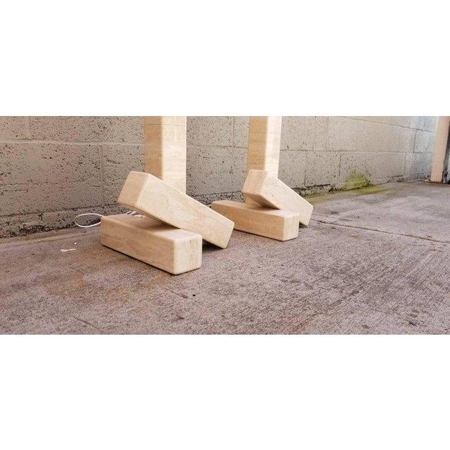 A pair of geometric block floor lamps made of travertine tiles. Two travertine off-set blocks balance travertine lamp...