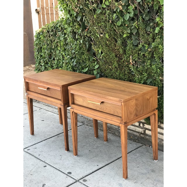 A pair of Mid-Century Danish Modern walnut basic Witz 'Basicanna' nightstands. The finish is in good condition as they...