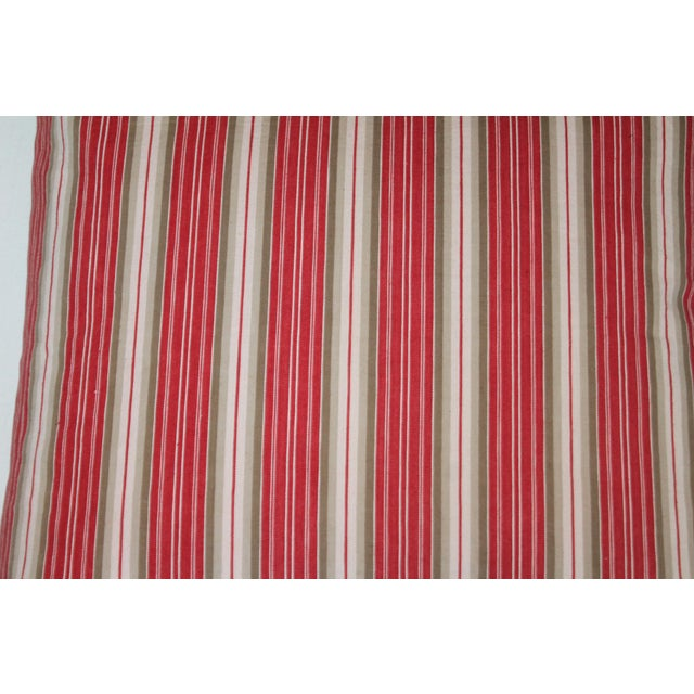 Ticking Pillow with a deep red background and white stripes. Down and feather filled and professionally laundered.