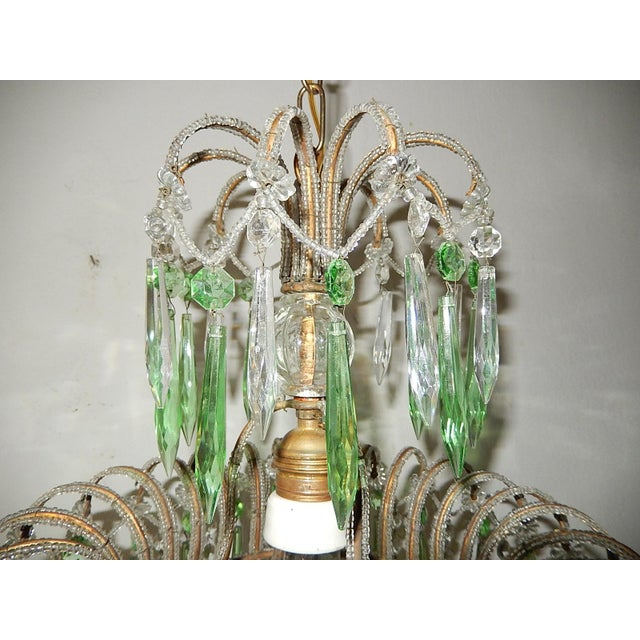 Housing 1 light in center. 3 tiers of crystals in rare green crystal and clear prisms. Plate on bottom with crystal ball...