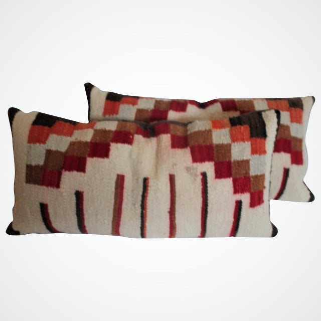 This pair of geometric block pattern Indian weaving pillows are in good condition with minor staining in small areas. The...