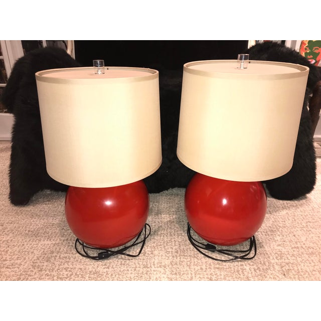 """Pair of Red Circular / Ball Baker Furniture Lamps Finial: Round clear Lucite (1.25"""" thick) Materials: Resin Base..."""