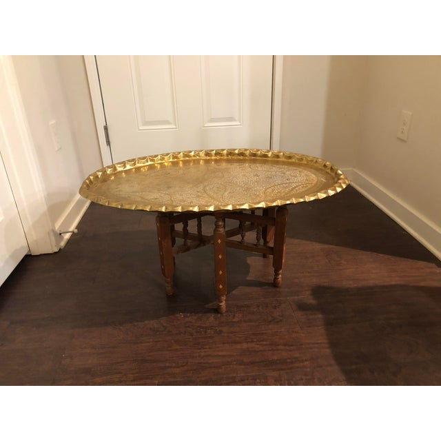Vintage tray table. Bright metal tray with leafy design detail on top and inlaid legs, perfectly worn. Folds up and easy...
