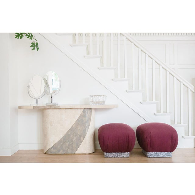 A pair of wool ottoman poufs. Made by Karl Springer in the style of mid-century modern.