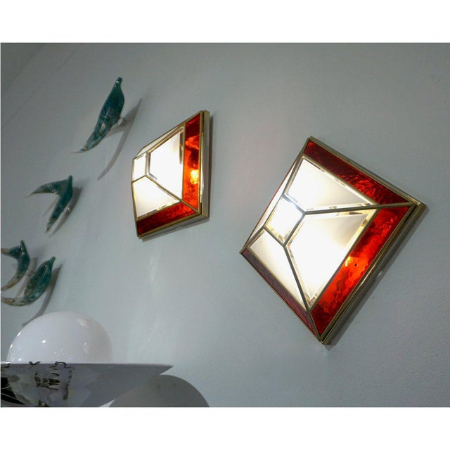 Italian 1950s pair of geometric modern design wall lights of Art Deco style, entirely handcrafted, high quality of...