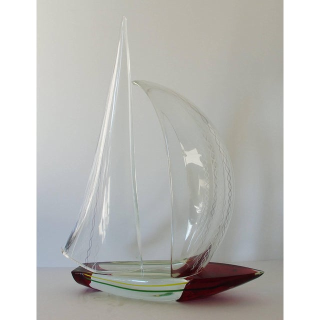 """Beautiful clear, red, green and yellow Murano glass sailboat by Alberto Dona. Signed """"Alberto Dona'"""" on the base of the..."""