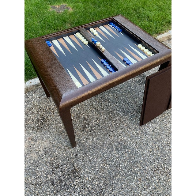 Incredible rich chocolate brown Karl Springer grasscloth covered backgammon table. Leather interior with navy and ivory...