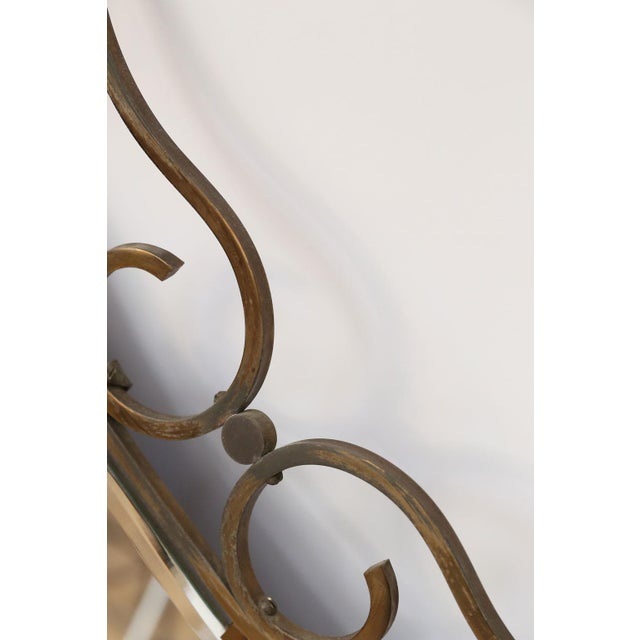 French vintage brass frame mirror from the 1960s. Remnants of gilt finish.