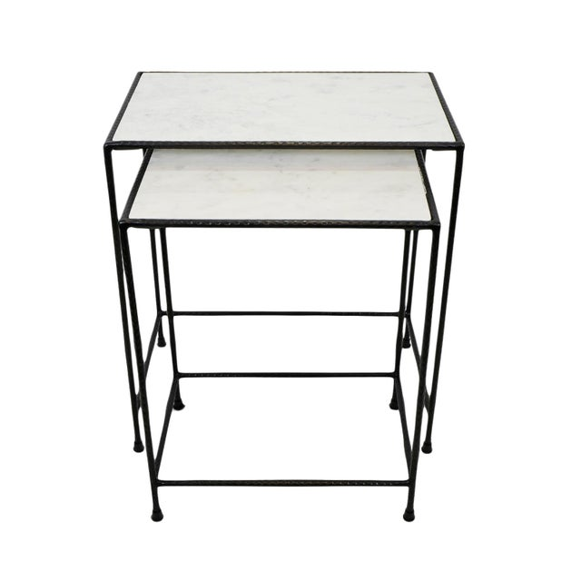 White marble top nesting tables with hand hammered iron frames. Each will have natural variations of tones and veining of...