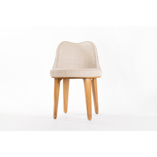 Edward Wormley for Dunbar. Swivel Chair designed in 1938. The Chair retains its original textured vinyl fabric. Legs...