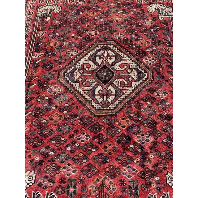 This is a vintage Persian Qasghi rug. The piece was handmade in the 1940s.