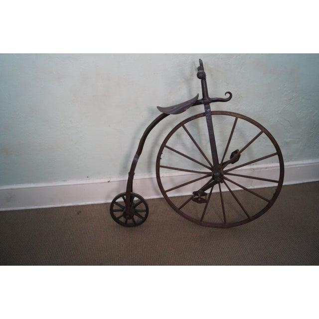 An antique, iron, high wheel bicycle that is 150 years old and was made in England. Store Item #: 10402 Heavy, hand...