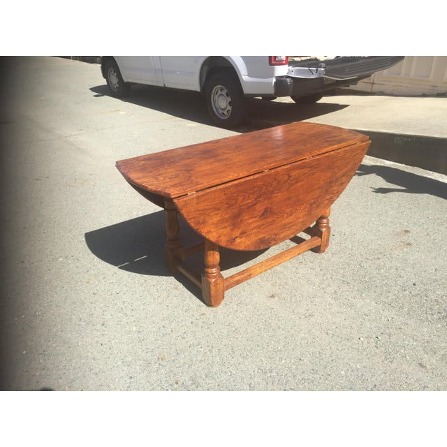 Solid oak table with drop leaves. Pull out support allows for easy seating. Hand hewn wood with doweled accents. Very...
