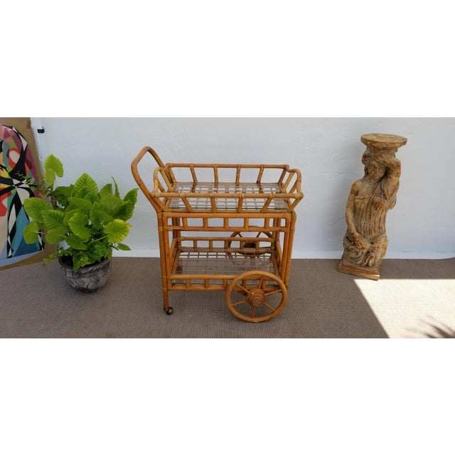 Vintage mid century bohemian rattan and bamboo rolling bar cart with removable serving tray features heavy duty bamboo...