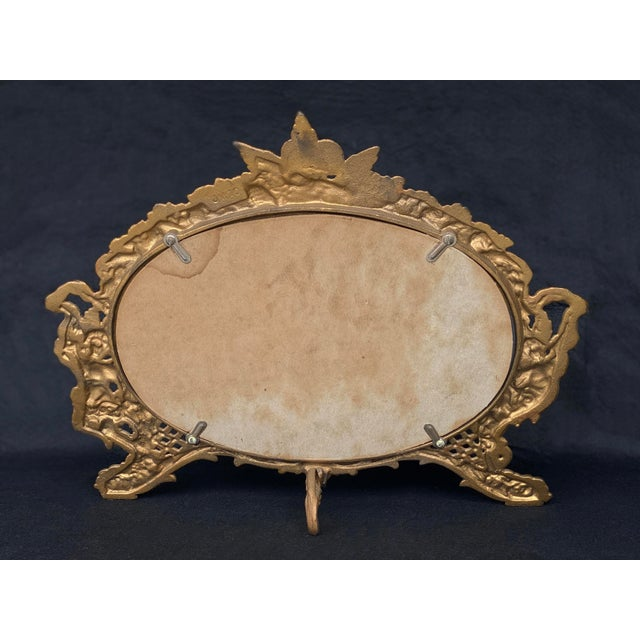 Vintage French Rococo Louis XV Gilded Brass Cherub Motif Oval Table Mirror For Sale - Image 4 of 10