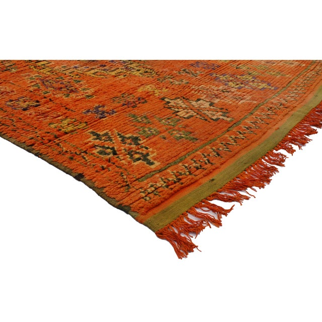 Impeccably woven from hand-knotted wool and displaying a modern tribal design, this vintage Berber Moroccan rug features a...