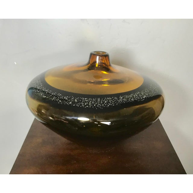 Large statement round bottleneck glass vase Beautiful on a coffee or side table Hues of amber and black with silver...
