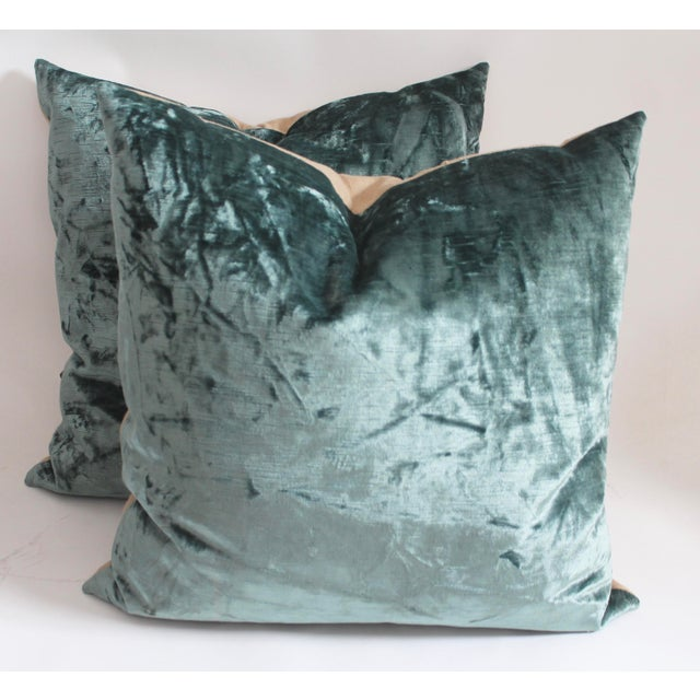Pair of Velvet pillows with linen backing, down and feather insert and zipper closure on bottom.